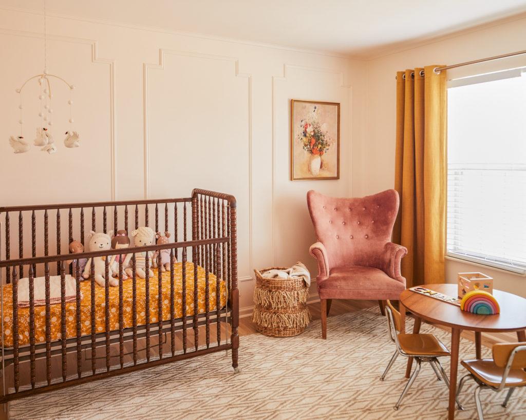 nursery design, velvet chair, vintage crib