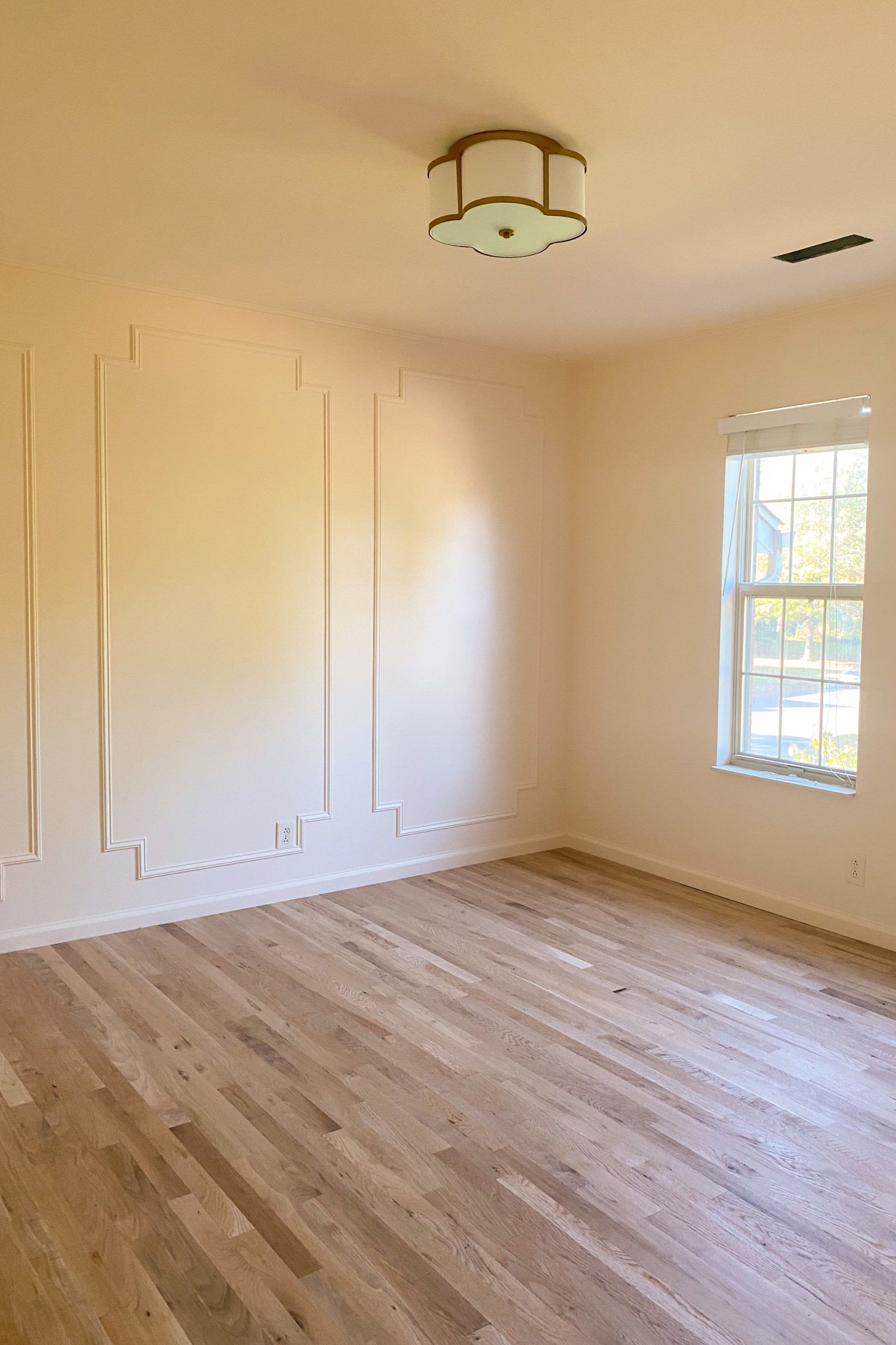 white oak floors, peach paint walls